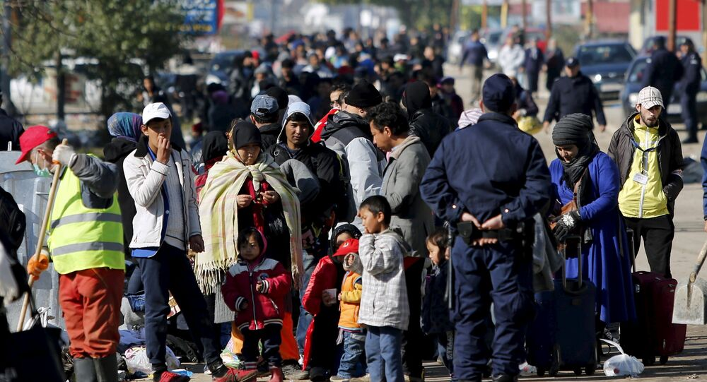 Migrants wait to enter a registration camp in Presevo, Serbia October 25, 2015