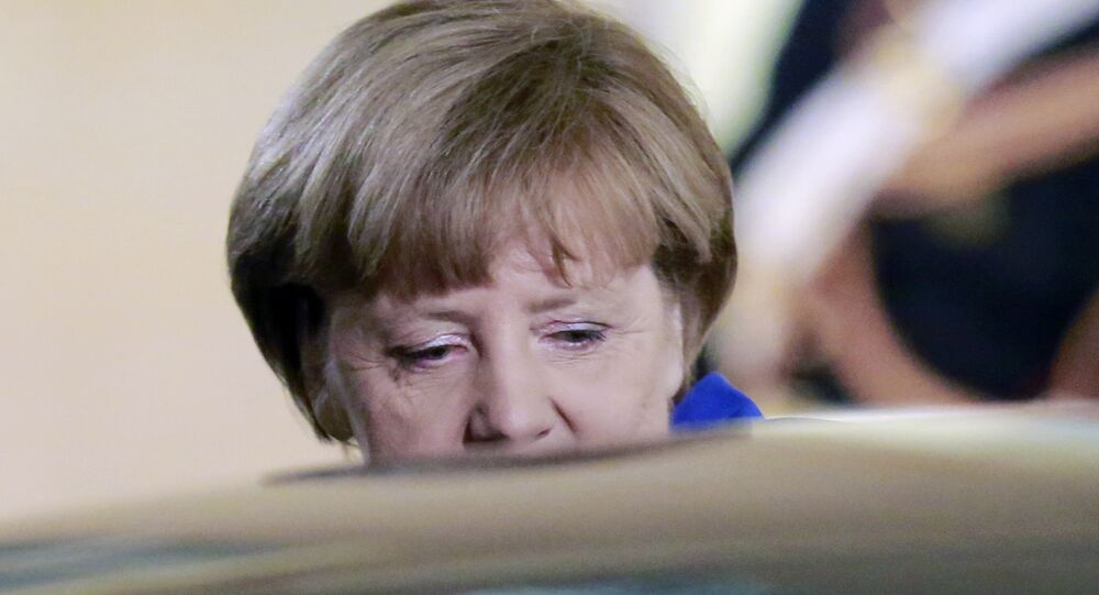 German Chancellor Angela Merkel leaves the Elysee Palace in Paris, France, after a a joint press conference with French President Francois Hollande, Friday, Oct. 2 , 2015.