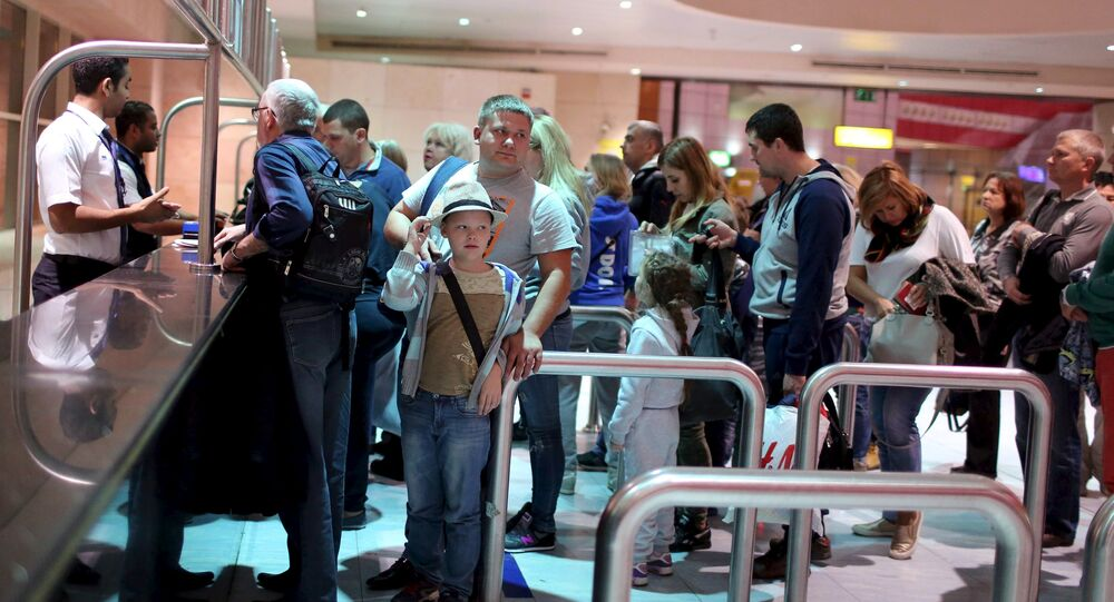 Russian tourists arrive to start their vacations at the airport of the Red Sea resort of Sharm el-Sheikh, Egypt November 6, 2015