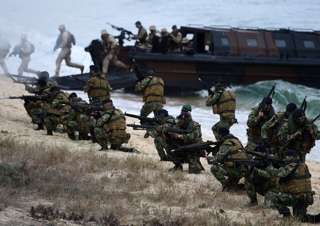 Portuguese Fuzileiros secure an area after disembarking from an amphibious transport during an exercise as part of the NATO's Trident Juncture 2015 in Troia, 100 kms south of Lisbon on November 5, 2015