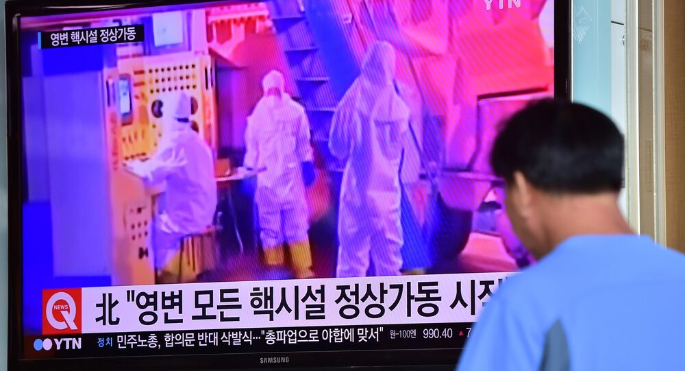 A man watches a news report at a railway station in Seoul on September 15, 2015, on the confirmation from North Korea that the nuclear reactor seen as the country's main source of weapons-grade plutonium had resumed normal operations, raising a further red flag amid growing signs the North may be considering a long-range rocket launch next month in violation of UN resolutions.