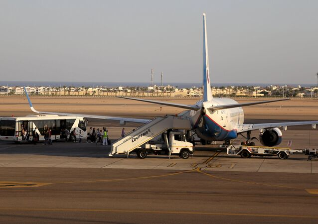 Passengers board a Russian airplane at the airport of the Red Sea resort of Sharm el-Sheikh, November 6, 2015