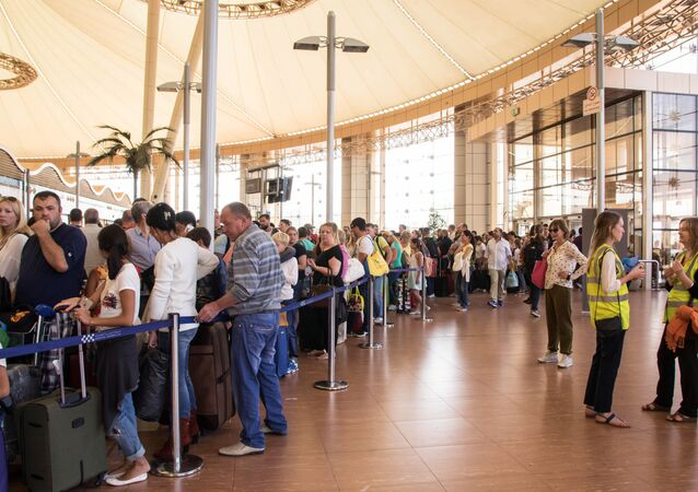 Tourists line up for luggage screening at the airport of Sharm el-Sheikh, Egypt, on Saturday, Nov. 7, 2015