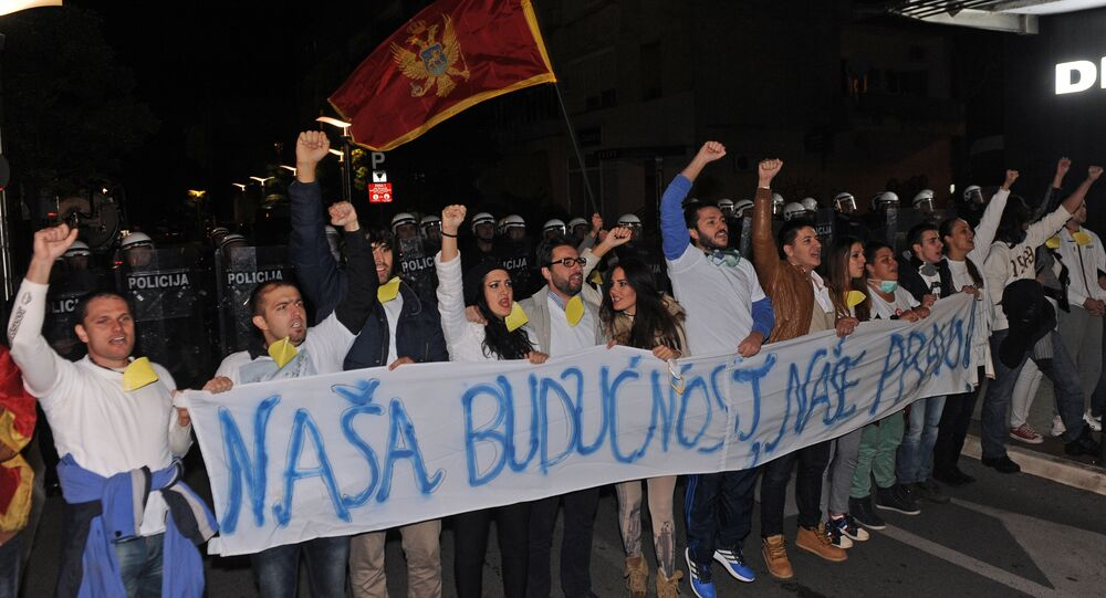 Montenegrin anti-government protesters carry a banner reading, Our future, our right during a protest in the capital Podgorica on October 24, 2015