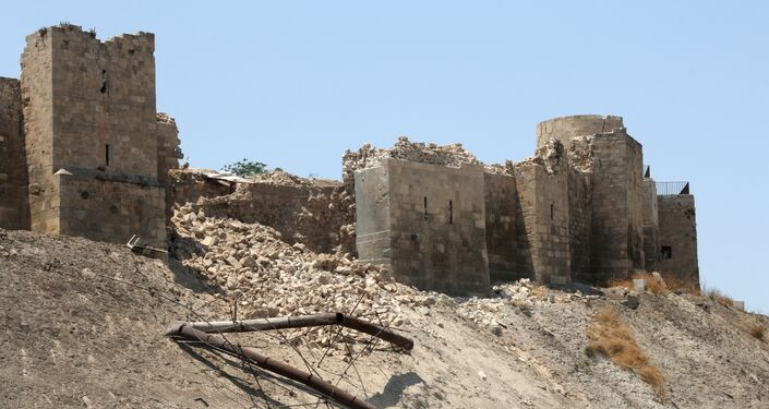 A picture taken on July 12, 2015, shows a damaged wall of Aleppo Citadel following a reported explosion the previous night in a tunnel near the monumental 13th fortress
