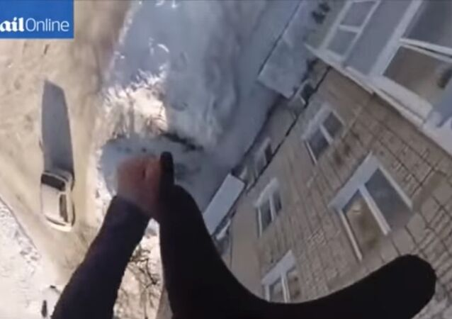 Russian daredevil jumps off 50ft-high building