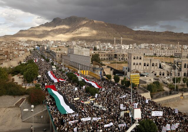 Houthi followers take part in a rally denouncing the Saudi-led air strikes in Yemen's capital Sanaa November 6, 2015