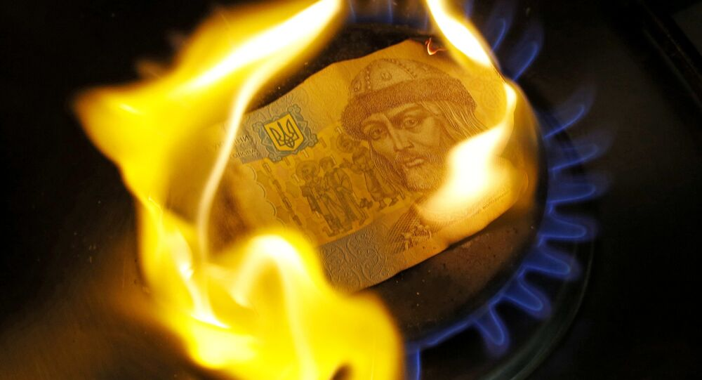 A burning one hryvnia bill on a gas burner