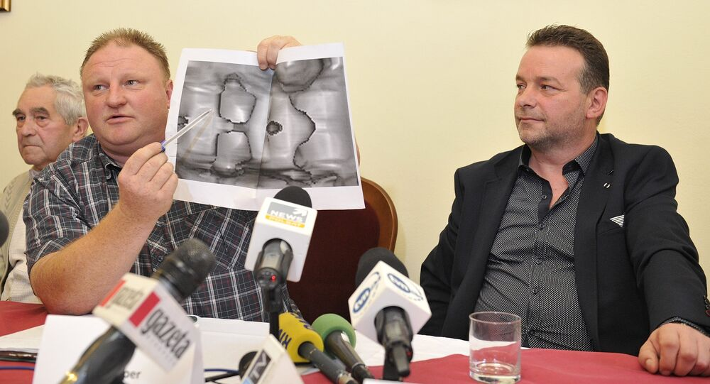 Andreas Richter (R) and Piotr Koper (L) present a ground-penetrating radar image representing according to them a World War II Nazi train during a press conference on September 18, 2015 in Struga near Walbrzych, Poland