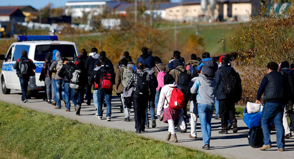 Migrants are escorted by German police to a registration centre, after crossing the Austrian-German border in Wegscheid near Passau, Germany, November 1, 2015