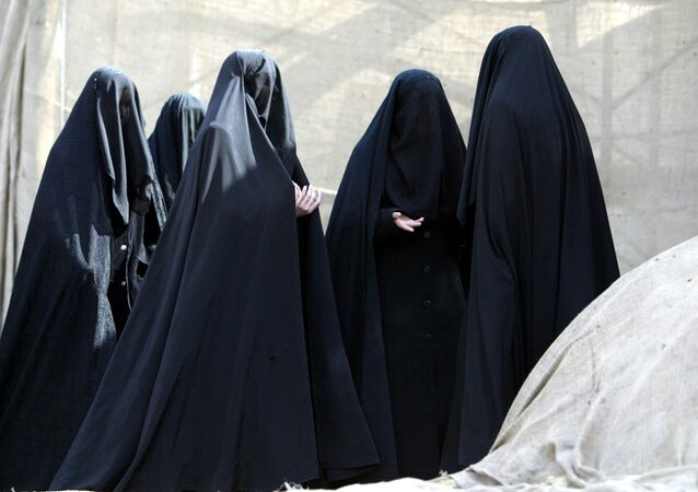 Turkish Shiite women stand during the Ashura ceremony, Halkali, in Istanbul