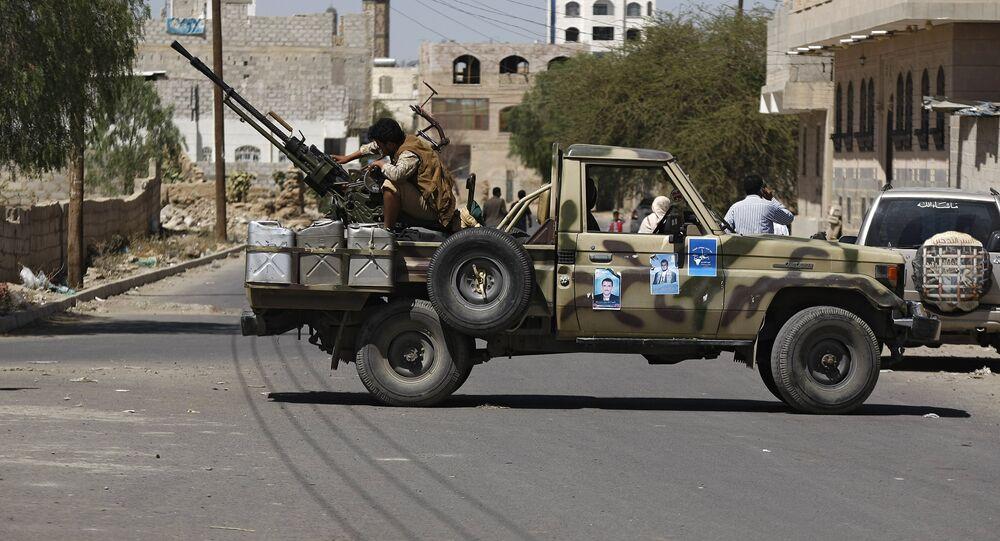 Houthi Shiite rebel mans a machine gun mounted on a military truck in Sanaa, Yemen, Monday, Oct. 20, 2014