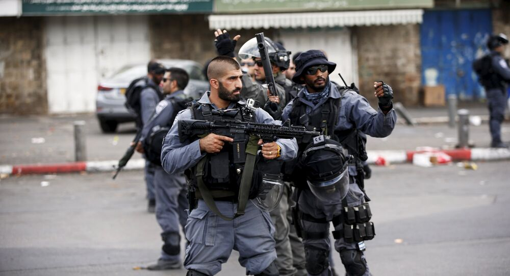 Israeli policemen secure the area where a Palestinian stabbed two Israeli Jews before he was shot dead outside Jerusalem's Old City