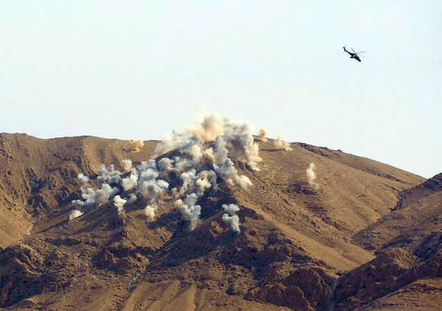 A file photo showing Russian Mi-24P attack helicopters conducting an air strike on terrorist's positions near the city of Palmyra