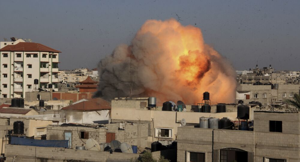 File photo of a ball of fire rises from an explosion following an Israeli air strike on the house in the southern Gaza Strip, Tuesday, Aug. 26, 2014