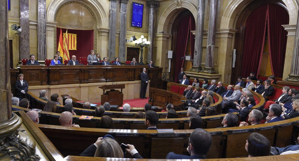 Carme Forcadell (C) delivers her first speech as Parliament's new president during the Catalan regional Parliament's constitutive session on October 26, 2015 in Barcelona
