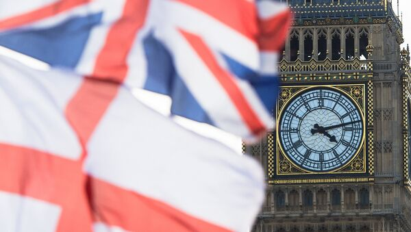 A British Union Jack flag and a flag of England fly in front of Big Ben in the Houses of Parliament in London, Britain, 02 April 2015 - Sputnik International