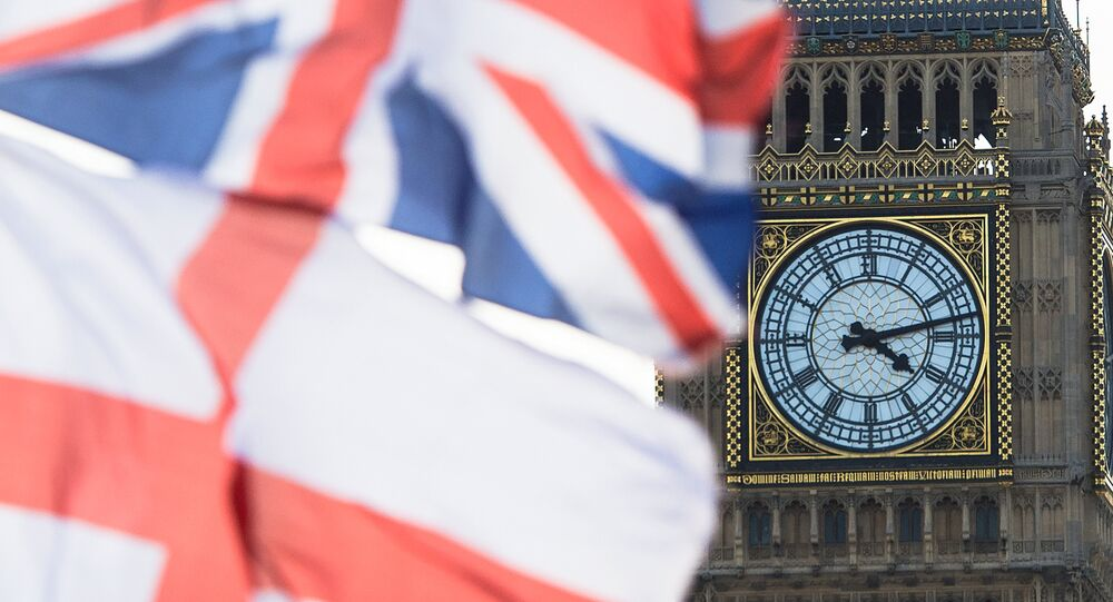 A British Union Jack flag and a flag of England fly in front of Big Ben in the Houses of Parliament in London, Britain, 02 April 2015