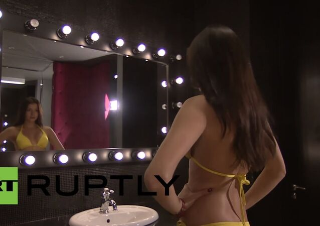Sofia Nikitchuk tries on swimsuits as she prepares for the Miss World showdown