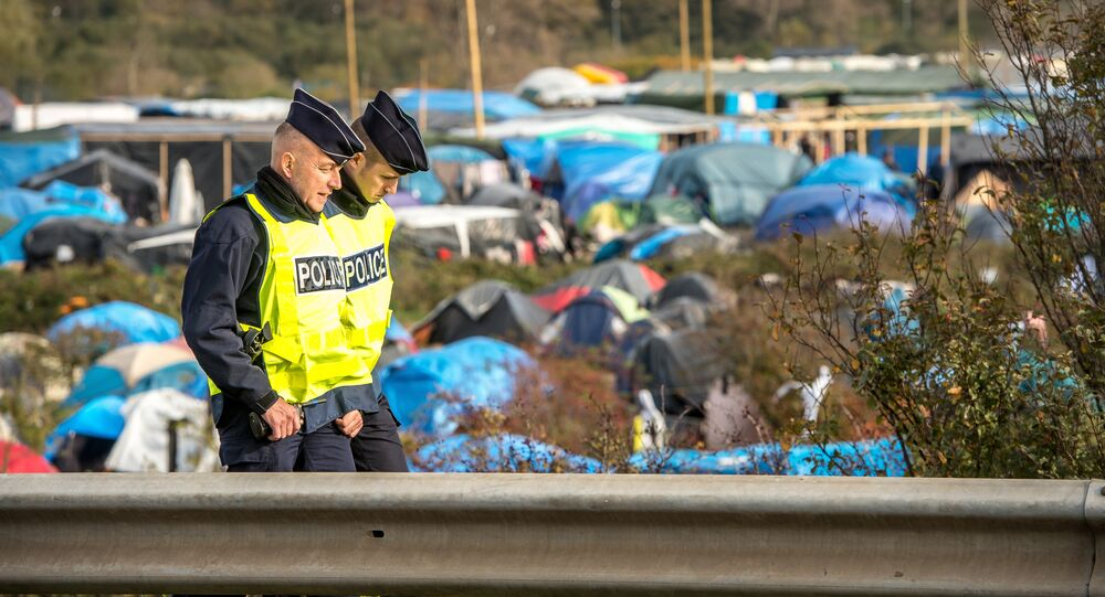 French policemen patrol on November 5, 2015 in the Jungle migrants camp in Calais