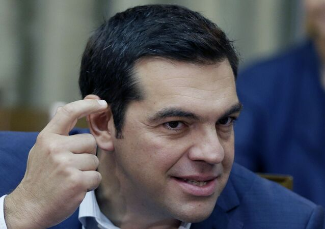 Greece's Prime Minister Alexis Tsipras gestures as he leads the first cabinet meeting of his new government in Athens, Friday, Sept. 25, 2015.