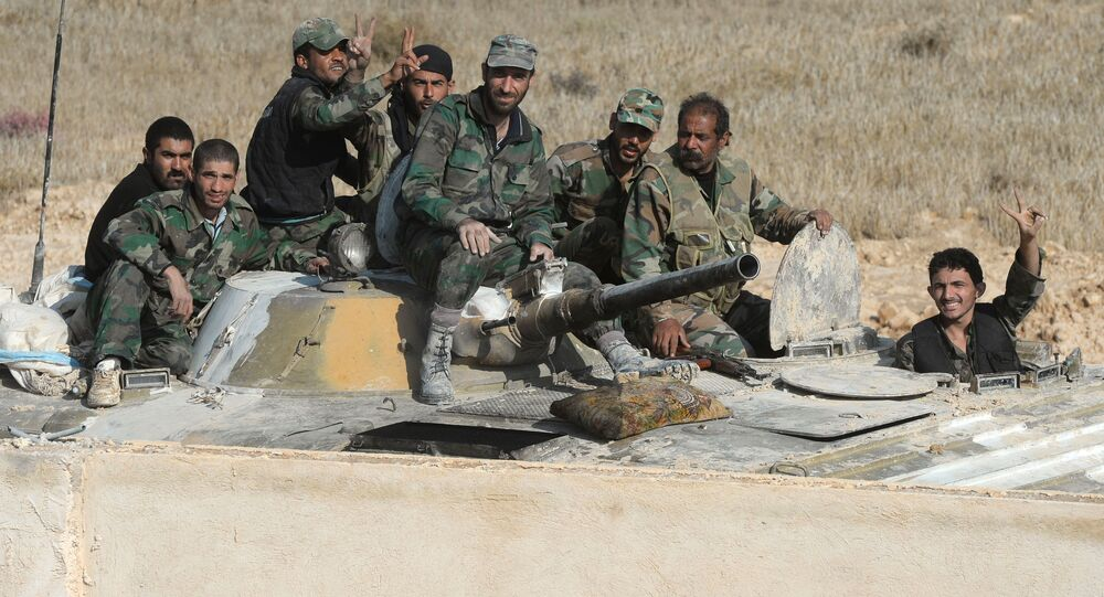 Soldiers of the Syrian Arab Army at fighting positions 20 kilometers from the city of Palmira