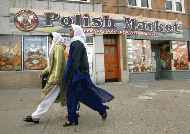 Muslim women walk past the Polish Market in downtown Hamtramck, Mich., Monday, April 19, 2004. In a sign of the deep changes in this once predominantly Polish town, City Council is expected Tuesday to pass a noise ordinance amendment that would permit mosques to issue the traditional call to prayer. But some longtime residents are resisting what they consider an affront to the religious freedom of non-Muslims.