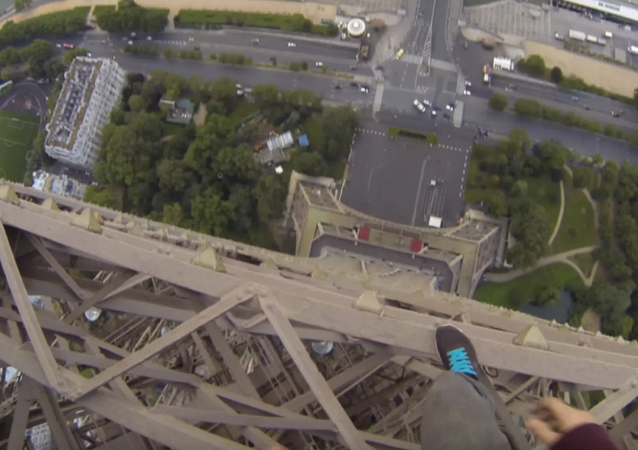 Man Climbs Eiffel Tower, and the Footage Is Terrifying