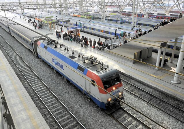 Mugunghwa train (front) is seen as passengers get off a train of the Korea Train eXpress (KTX), South Korea's high-speed rail system based on the French TGV/LGV system.