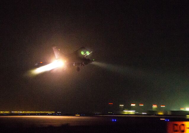 This photo released on Friday, Oct. 9, 2015 by the French Army Communications Audiovisual office (ECPAD) shows a French army Rafale fighter jet taking off from an undisclosed air base as part of France's Operation Chammal launched in September 2015 in support of the US-led coalition against Islamic State group.