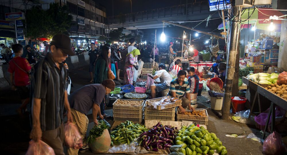 In this photo taken on July 11, 2015, Indonesians buy food at the Jakarta night market.
