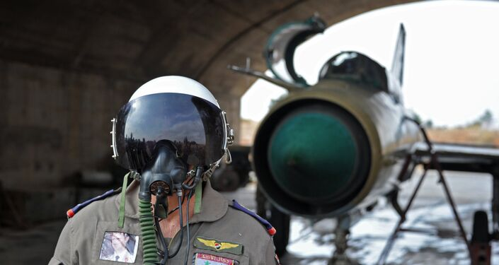 A Syrian pilot at the Hama airbase near the city of Hama, Syria's Hama Province.