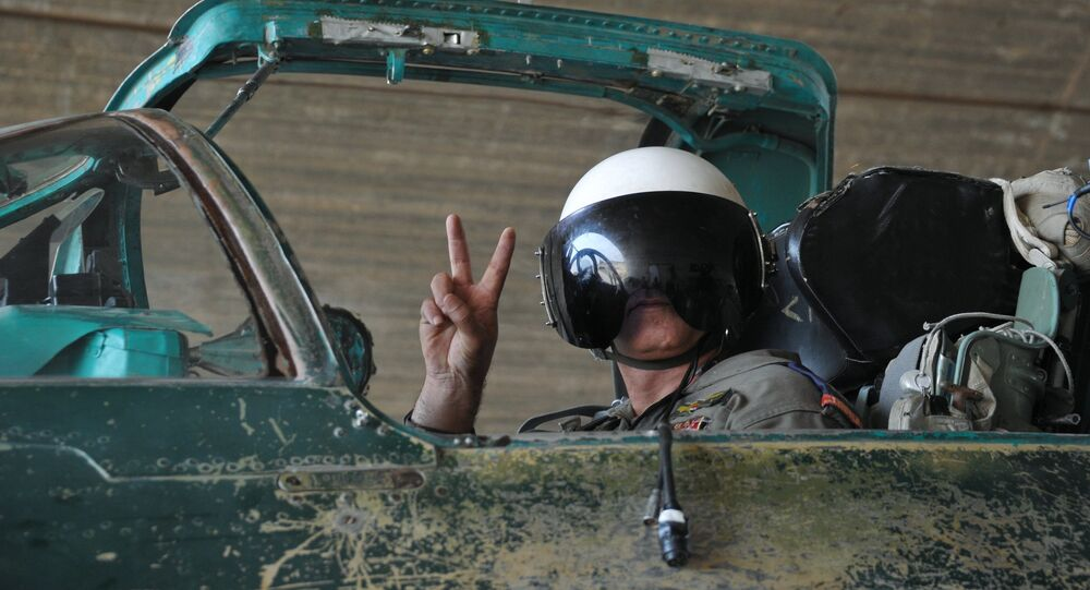A Syrian pilot before a mission at the Hama airbase near the city of Hama, Syria's Hama Province.
