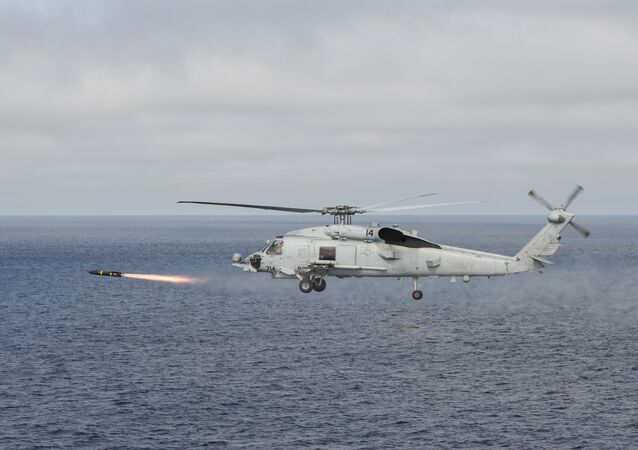 An MH-60R Sea Hawk helicopter attached to the Raptors of Helicopter Maritime Strike Squadron (HSM) 71 fires an AGM-114 Hellfire missile during a training exercise over the Pacific Ocean