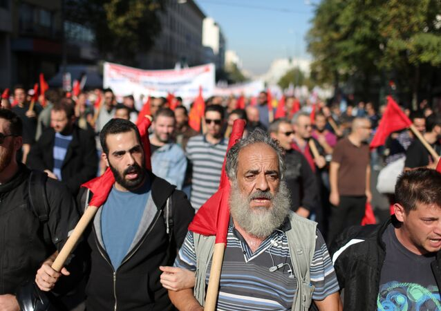 Members of the PAME Communist-affiliated union protest during a 24-hour nationwide general strike in Athens, Thursday, Nov. 12, 2015.
