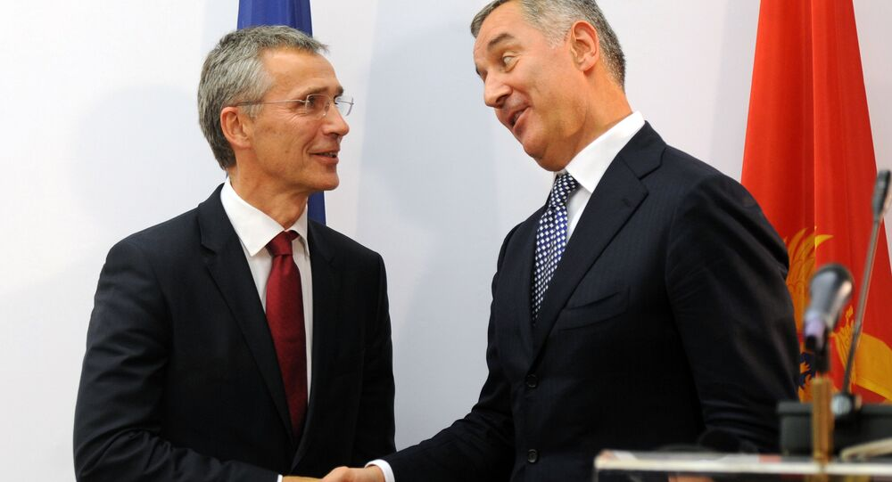 Montenegro's Prime Minister Milo Djukanovic (R) shakes hands with NATO Secretary General Jens Stoltenberg after a joint press conference in Podgorica