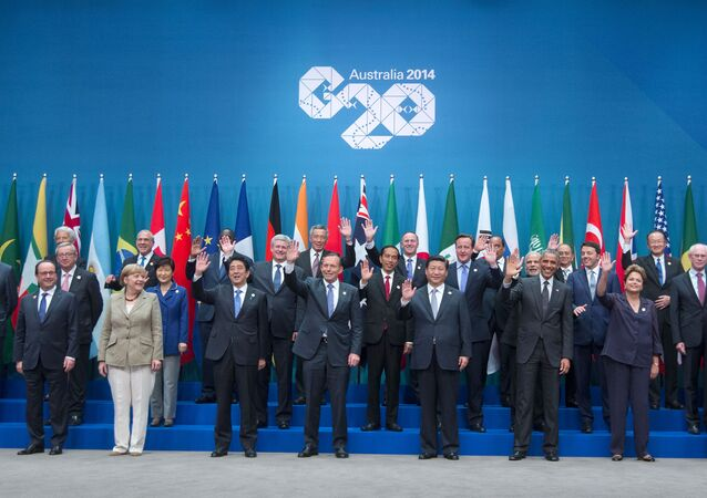 Leaders pose for a group photo at the G20 summit in Brisbane, Australia, Saturday, Nov. 15, 2014.