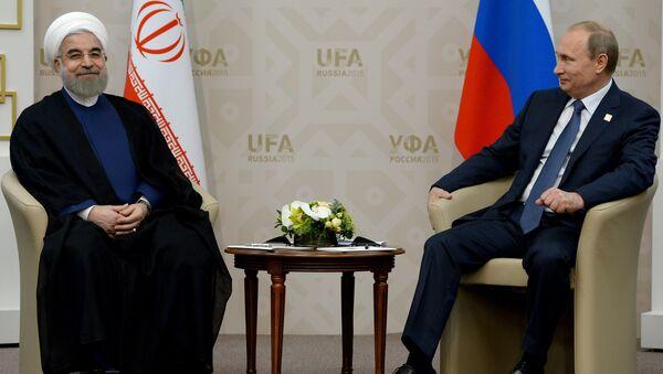 President of the Russian Federation Vladimir Putin, right, and President of the Islamic Republic of Iran Hassan Rouhani - Sputnik International