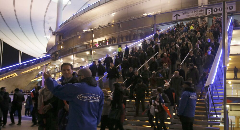 Crowds leave the Stade de France where explosions were reported to have detonated outside the stadium during the France vs German friendly match near Paris, November 13, 2015