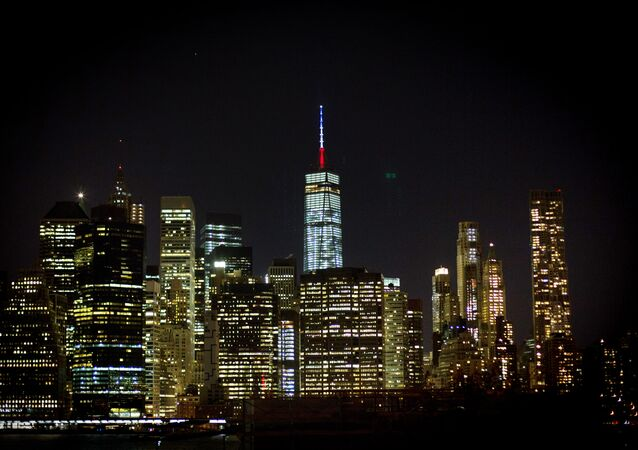 The One World Trade Center spire is lit blue, white and red after New York Gov. Andrew Cuomo announced the lighting in honor of dozens killed in the Paris attacks Friday, Nov. 13, 2015, in New York