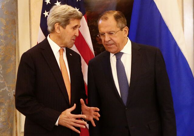 Russia's Foreign Minister Sergei Lavrov (R) and US Secretary of State John Kerry talk before a conference on the Syria conflict in Vienna, Austria, on November 14, 2015
