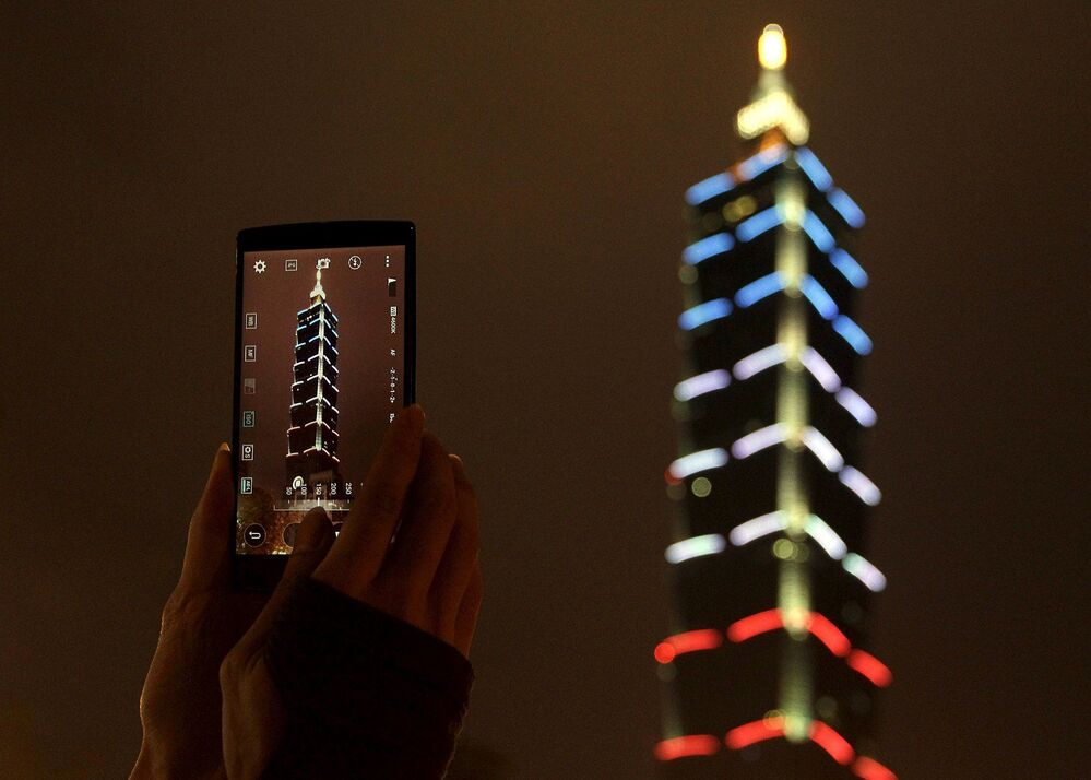 Taiwan's supertall Taipei 101 skyscraper lit in French red-white-and-blue colors to commemorate the victims of the November 13th Paris deadly terrorist attacks.