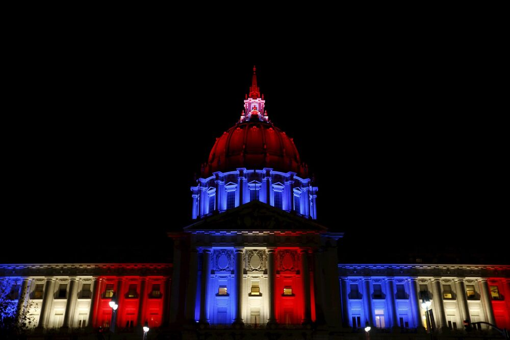 San Francisco City Hall, USA, lit up in the French national colors in solidarity with France after eight extremists wearing explosive belts attacked several venues across Paris, killing 129 people.
