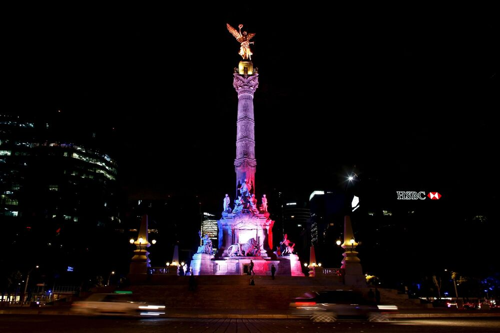 The Angel of Independence monument in Mexico's capital lit in red, blue and white French colors in remembrance of the victims of the November 13th Paris terror attacks.