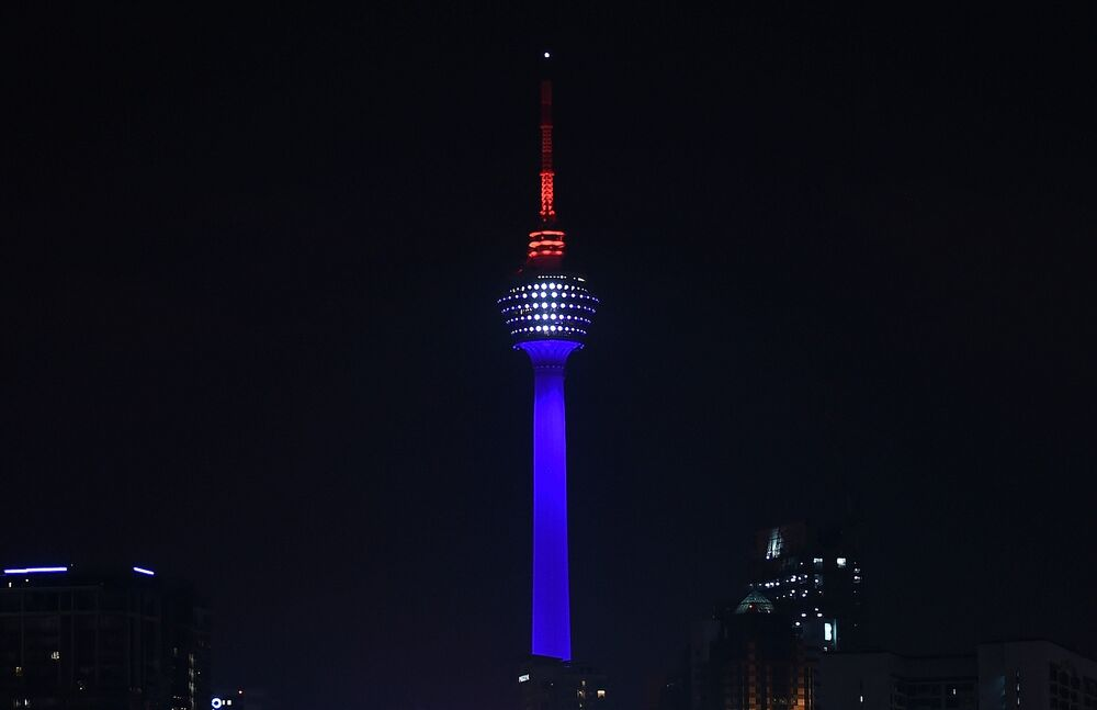 Malaysia's landmark KL Tower is lit up in red, white and blue, resembling the colours of the French flag, in Kuala Lumpur to commemorate victims of November 13th's deadly terrorist attacks in Paris.