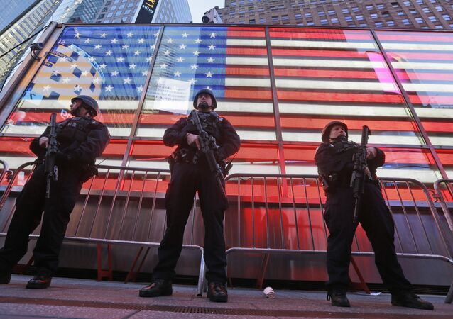 Heavily armed New York city police officers with the Strategic Response Group stand guard at the armed forces recruiting center in New York's Times Square, Saturday, Nov. 14, 2015. Police in New York say they've deployed extra units to crowded areas of the city out of an abundance of caution in the wake of the attacks in Paris, France