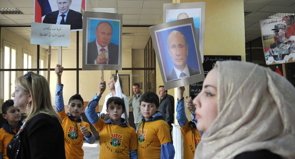 Young residents of Latakia, Syria attend a rally to mark the Russian holiday of National Unity Day and to express gratitude to Russia for its combat operation in their country