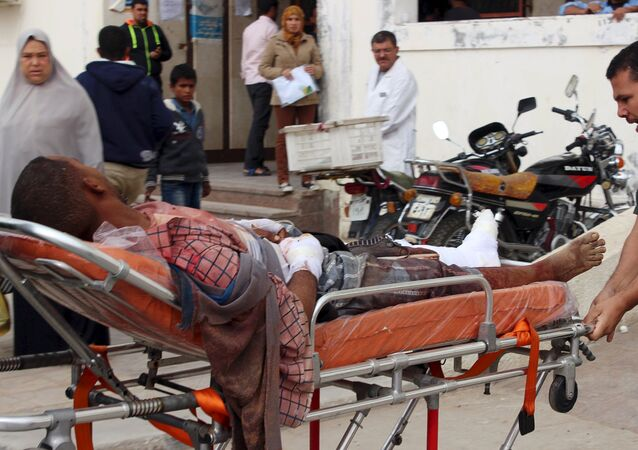 An African migrant, who was wounded during gunfire near the border with Israel, lies on a stretcher as he is taken to the hospital at Al Arish city, in the northern part of Sinai peninsula, Egypt, November 15, 2015