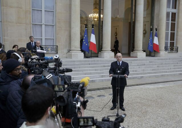 French Interior Minister Bernard Cazeneuve delivers a statement in the courtyard of the Elysee Palace in Paris, France, November 14, 2015, after an extraordinary ministers' meeting, the day after a series of deadly attacks in Paris