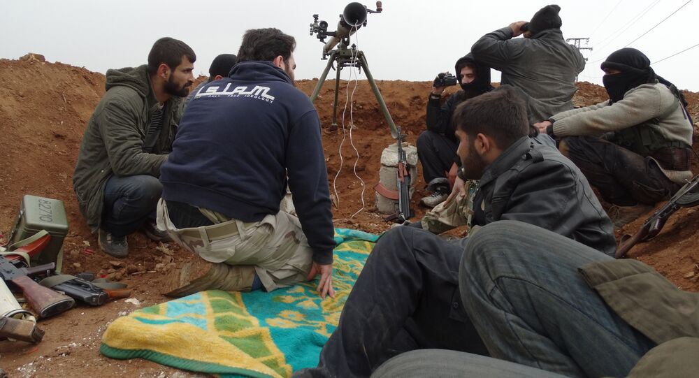 Opposition fighters from the Ahrar Al-Sham brigade, part of the Islamic front coalition, hold a position in the Sheikh Lutfi neighbourhood of the northern Syrian city of Aleppo during ongoing clashes with government forces on January 27, 2014